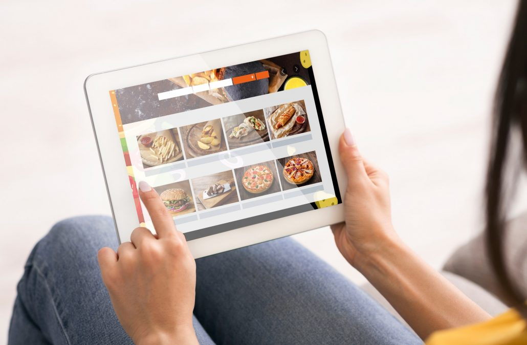 Woman Using Digital Tablet Ordering Food Delivery Online At Home